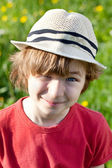 Ruffled the boy in a hat — Stock Photo