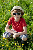 The blond boy in shorts and a panama hat — Stock Photo
