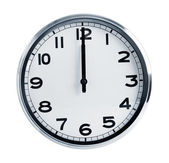 Wall office clock showing at noon — Stock Photo