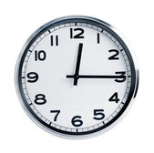 Wall office clock in a metal case — Stock Photo