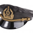 Black navy cap with the golden emblem of an anchor — Stock Photo