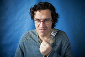 Man threatening species with fork in hand — Stock Photo