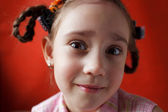 Little surprised girl with pigtails — Stock Photo
