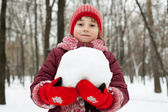 Little girl with a snowball in his hands — Stock Photo