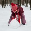 The little girl was lying a snowman — Stock Photo #8486156