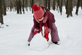The little girl was lying a snowman — Stock Photo