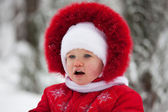 Little girl in a red winter suit — Stock Photo