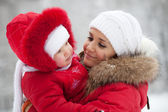 Young mother with her baby daughter — Stock Photo