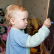 Little girl draws with chalk on a blackboard — Stock Photo