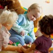 Little girl playing with dolls — Stock Photo