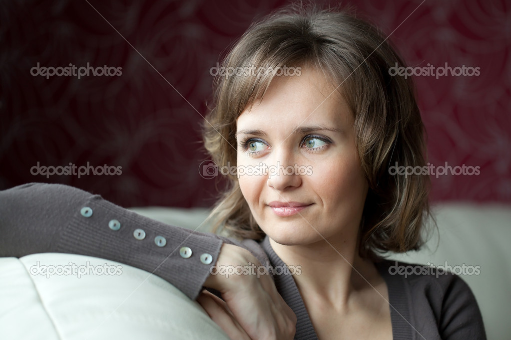 Young woman sitting and looking out the window  Stock Photo #8677357
