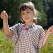 Stock Photo: Little girl caught in meadow grasshopper