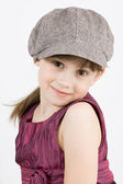 The little fashionista in cap and gown — Stock Photo