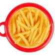 Pasta in a circular bank of red o - Stock Photo