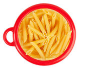 Pasta in a circular bank of red o — Stock Photo