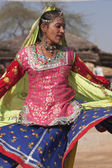 Female Indian dancer from Rajasthan in action at the annual Sarujkund Fair near Delhi in India. — Stock Photo