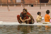 Woman Washing In Old Delhi Mosque — Stock Photo