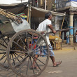 Hand Pulled Rickshaw In Calcutta - Stock Photo