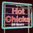 Stock Photo: Hot chicks neon sign