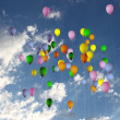 Colored balloons up in the sky — Stock Photo