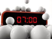 Digital alarm clock under falling spheres — Stock Photo