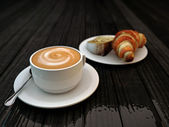 Cappucino and croissant — Stock Photo