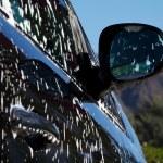 Black car soapy — Stock Photo