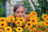 Happy Girl in Flower Garden — Stock Photo