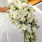 Brides white lilies — Stock Photo