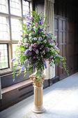 Purple flowers at wedding. — Stock Photo