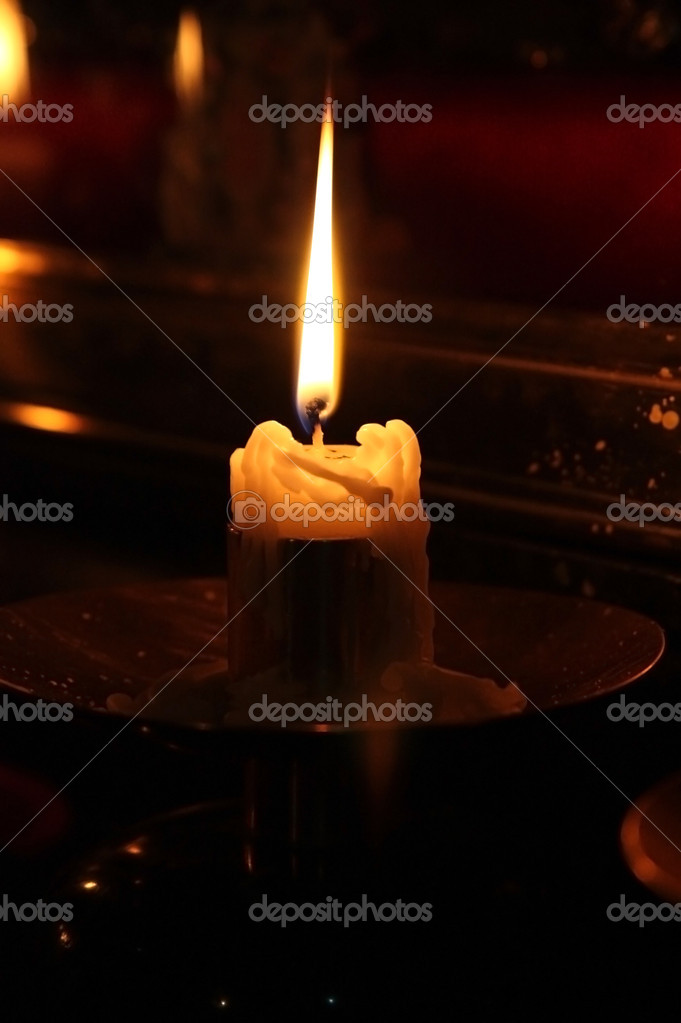 Candle in orthodox church  Stock Photo #7989923