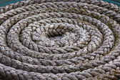 Coiled Mooring Rope on a Quayside — Stock Photo