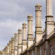 Stock Photo: Row of Old Chimneys