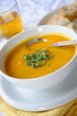 A bowl of carrot and lentil soup — Stock Photo