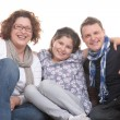 Young family close on couch — Stock Photo