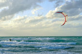 Man kite-surfing in Atlantic Ocean with dramatic weather — Stock Photo