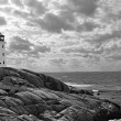 Stock Photo: Lighthouse in dramatic sky, black and white