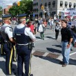 Protester hollers at 2 Royal Canadian Mounted Police - Stock Photo