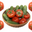 Fresh tomato and cucumbers in basket on a white - Photo