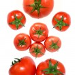 Fresh red tomato on white back — Stockfoto