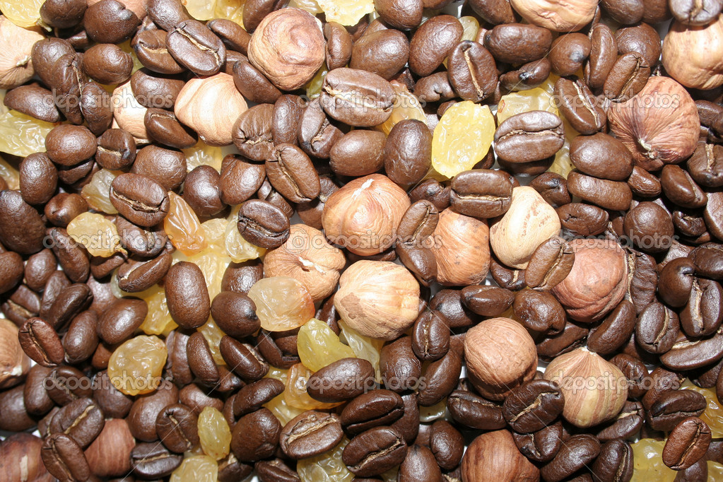 Coffee grains, nuts and raisin for texture. — Stock Photo #10538471