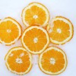 Foto Stock: Orange slices on snow