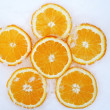 Orange slices on snow — Stock Photo
