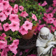 Angel Statue in Petunias — Stock Photo