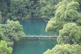 Bridge on blue water — Stock Photo