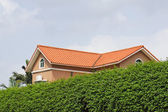 Villa with green fence — Stock Photo