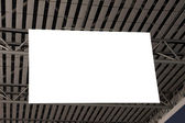 Blank sign post hanged on the ceiling — Stock Photo