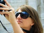 Beautyful girl taking photo — Stock Photo