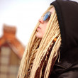 Stock Photo: Young beautiful blonde with dreadlocks in sun glasses and hood