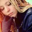 Stock Photo: Young beautiful blonde with dreadlocks and pirsing
